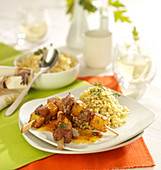 Duck magret and pineapple brochettes , wheat with fresh thyme