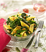 Pan-fried spinach with omelette and grilled pine nuts
