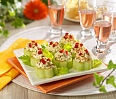 Cucumber flowers garnished with feta, diced red pepper and cumin