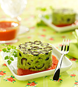 Broccoli mousse with black olives and red pepper coulis