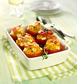Tomatoes stuffed with corn semolina, mozzarella and pancetta crisps