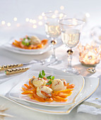 Scallops and stewed carrots with orange