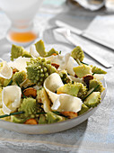 Romanesco cabbage and parmesan salad on a bed of fried garlic