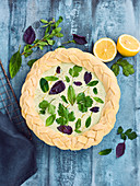 Brousse cheese and herb pie with braided pastry edges