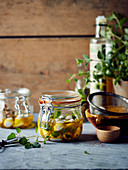 Jars of marinated mozzarella balls with oil and herbs
