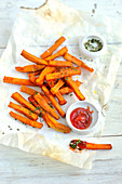 Sweet potato chips, ketchup, mixed chopped herbs and sea salt