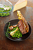 Rack of lamb in Raclette de Savoie crust and broad beans with garlic and spring onions