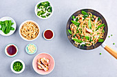 Noodles sauté,chicken, pea and sweet pea wok