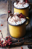 Mugs of spicy hot chocolate topped with whipped cream