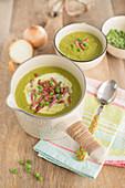 Cream of pea soup with diced bacon