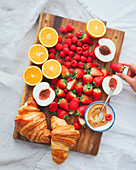 Tray of croissants and fruit
