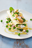 Lasagna with smoked mackerel, fresh goat cheese and peas