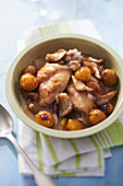 Sauté of rabbit with beer, oyster mushrooms and mirabelle plums