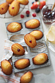 Madeleines filled with red fruit jam