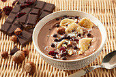 Chocolate, banana, hazelnut and cranberry fruit bowl