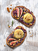 Red onion, thyme,Crottin de chèvre, walnut and fig open sandwiches