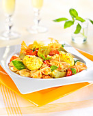 Farfalle with monkfish, artichokes, saffron and basil