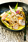 Chinese noodles with fish and mushrooms, lime and ginger sauce
