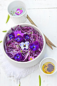 Red cabbage, pansy and primrose salad