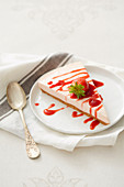 Slice of cheesecake with strawberry coulis