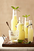 Glass and bottles of homemade lemonade