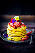 Cornflour pancakes with pomegranate and strawberries