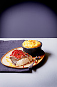 Hake steak with tomatoes and pink pepper,parsnip soufflé