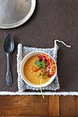 Cream of orange lentil and carrot soup,crispy bacon
