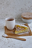 Slice of magic grilled pine nut cake for tea