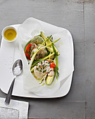 Papillote of scallops with chives, avocado and green asparagus strips with dill