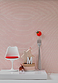 Giant fork and cherry tomato with a miniature designer's chair,rabbit figurine and gifts