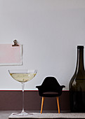 Giant glass and bottle of Champagne with a miniature designer's armchair
