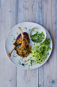 Lamb chops marinated in crème fraîche and curry,sprout salad and yoghurt sauce