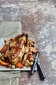 Roasted guinea-fowl with white grapes,cranberries and pumpkin