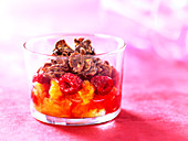 Orange and raspberry fruit salad topped with chocolate coated cornflakes