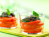 Glasses of tomato,black olive and basil salad