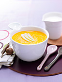 Cream of carrot and green apple soup with nutmeg