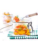 Ope, jar of salmon marinated in olive oil and seasonings