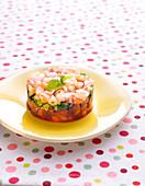 Strawberry and gambas tartare with basil