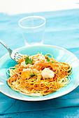Spaghettis in tomato sauce,scallops and shrimps