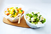 Three Steamed Cabbage Bowl And Steamed Sweet Potato,Yellow Carrot,Parsnip And Pea Bowl