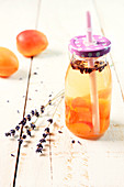 Small bottle with straw lid of apricot-lavander-flavored water