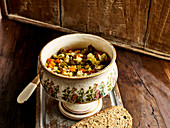 Vegetable soup in an old-fashioned soup bowl