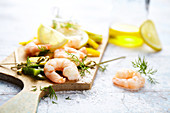 Shrimp,peppers,lemon,dill and Fleur de sel sea salt on a chopping board