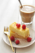 Coconut cake topped with fresh raspberries