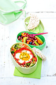 Noodles With Vegetables And An Egg Cooked In Half A Red Pepper Bento And Fruit Salad Bento
