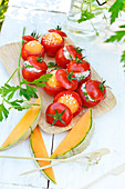 Tomatoes stuffed with melon and tomatoes stuffed with fromage frais