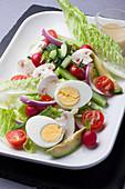 Cherry tomato, hard-boiled egg, cucumber, avocado, pink radish and button mushroom salad