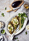 Grilled aubergines stuffed with bulgur and mozzarella,oil and parsley