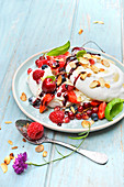 Pavlova with almonds and summer fruit